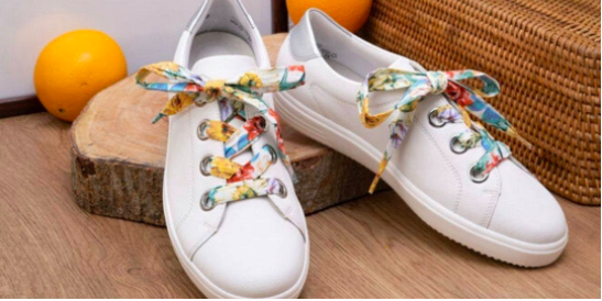 white trainers with floral laces